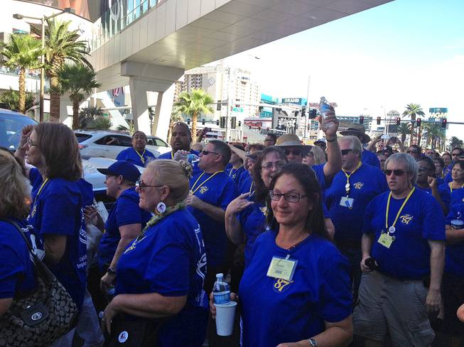 Members of the California School Employees Association — clad in blue — protest outside the Cosmopolitan, Wednesday, July 31, 2013.