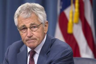 Defense Secretary Chuck Hagel pauses during a news conference at the Pentagon, Wednesday, July 31, 2013.