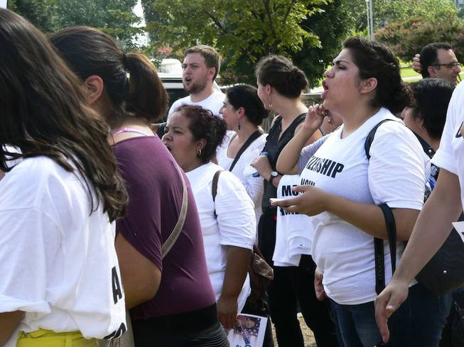 Astrid Silva, an activist with PLAN and a Nevada immigrant with deferred action status, chants pro-immigration slogans at a demonstration at the Longworth House Office Building in Washington, D.C., on Thursday, July 31, 2013.