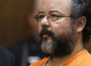 Ariel Castro listens in the courtroom during the sentencing phase Thursday, Aug. 1, 2013, in Cleveland.
