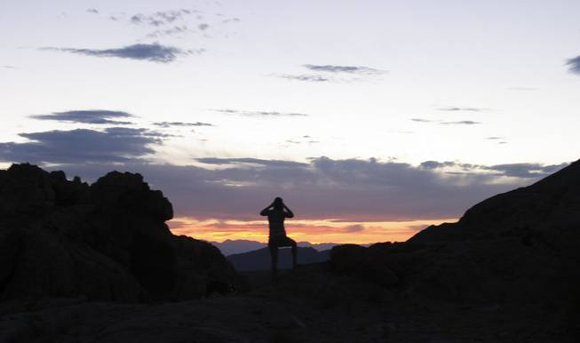 Chiara Velotta photographs the disappearing sun at Gold Butte, Aug. 3, 2013.