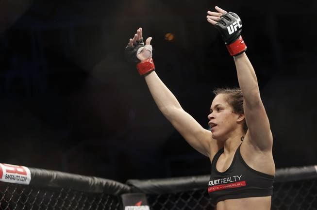 Amanda Nunes, from Brazil, celebrates after defeating Sheila Gaff, from Germany, during their UFC 163 mixed martial arts Women's Bantamweight bout in Rio de Janeiro, Brazil, Saturday, Aug. 3, 2013.