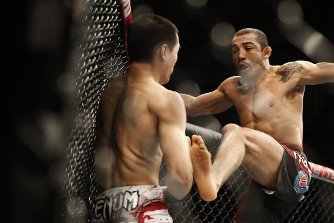Jose Aldo, from Brazil, right, and Chan Sung Jung, from South Korea, battle during their UFC 163 mixed martial arts Featherweight Championship bout in Rio de Janeiro, Brazil, Sunday, Aug. 4, 2013. Aldo defeated Jung and kept his Championship belt.