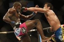 Lyoto Machida, from Brazil, right, and Phil Davis, from the U.S., battle during their UFC 163 mixed martial arts Light Heavyweight bout in Rio de ...