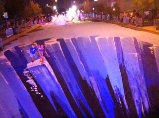 A blocklong section of Casino Center Boulevard has been transformed into an ice-themed 3-D street mural for First Friday on Aug. 2, 2013.