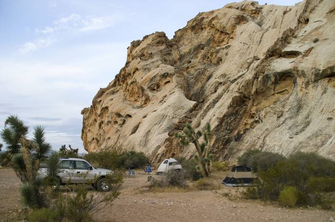 A campsite is seen in the Whitney Pockets area of Gold Butte, Aug. 4, 2013. Sandstone rock formations and Joshua trees protect primitive campsites.