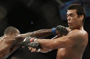 Lyoto Machida, from Brazil, right, and Phil Davis, from the U.S., battle during their UFC 163 mixed martial arts Light Heavyweight bout in Rio de Janeiro, Brazil, Sunday, Aug. 4, 2013. (AP Photo/Felipe Dana)