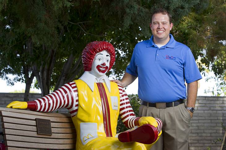 Jeremy Anderson, general manager of Aire Serv, poses by a statue of Ronald McDonald at the Ronald McDonald House Monday, Aug. 5 2013. The The Ronald McDonald House provides temporary housing for families who travel to Las Vegas to receive critical medical treatment for their children.