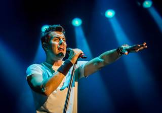 311 frontman Nick Hexum performs at the Joint in the Hard Rock Hotel on Sunday, Aug. 4, 2013.