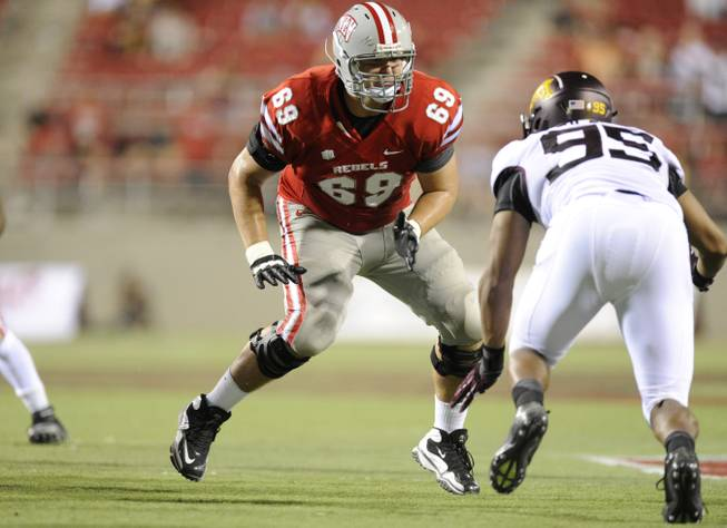 UNLV offensive lineman Brett Boyko moves his feet to make a block during the Rebels 2012 season opener against Minnesota at Sam Boyd Stadium.