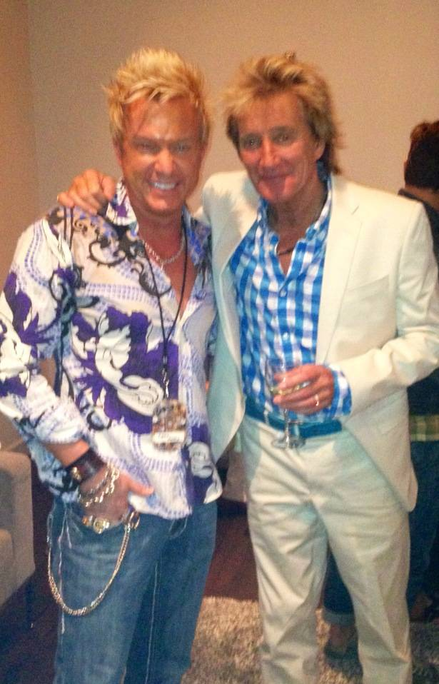 An ebullient Chris Phillips, left, meets Rod Stewart.