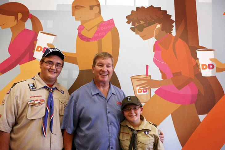 Charlie Mootz, center, with Donald Swanson, 17, and his brother James Swanson, 11, inside the Dunkin' Donuts franchise that he owns in Henderson on Tuesday, Aug. 6, 2013.