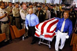 Ernesto Velasquez, left, father of Angel Velasquez, and Ricky Medrano, the stepdad of Angel Velasquez, carry the casket out after the service for Angel Velasquez at Trinity Life Center in Las Vegas on Wednesday, August 7, 2013. The 19-year-old Metro Explorer was killed August 1 by a suspected impaired driver.