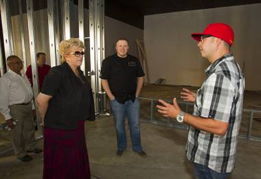 "Las Vegas Mayor Carolyn Goodman listens to Roberto Mendosa as she tours the future site of the Banger Brewing Company in the Neonopolis Mall in downtown Las Vegas Thursday, Aug. 8, 2013. Michael ""Banger"" Beaman looks on at center. The brewery is expected to open in the mall in mid-October, Mendoza said."