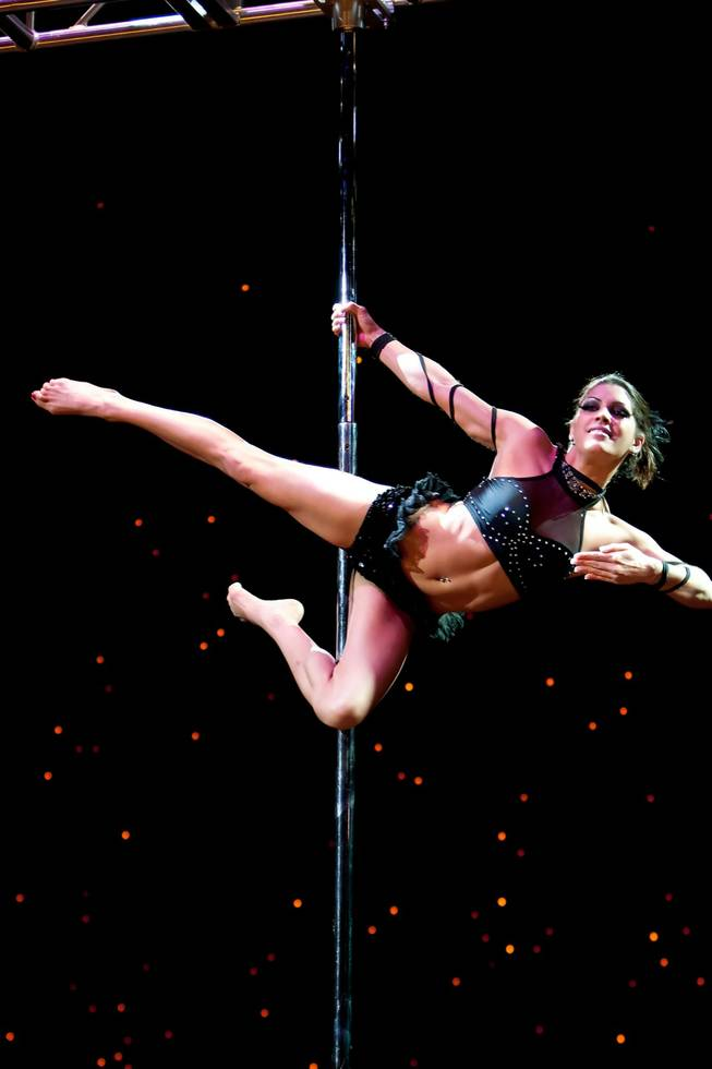 Artist Ms. Polorama performs during the amateur Championship Level 3 Senior competition at the 2013 U.S. National Pole Championships at the Tropicana Hotel in Las Vegas Friday night, August 9, 2013.