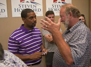 Mesquite resident John Williams, right, discusses the proposed Gold Butte National Conservation area with Nevada 4th District Congressman Steven Horsford on Friday at Horsford's campaign headquarters in North Las Vegas after Horsford announced his intention to run for re-election in 2014 to a gathering of constituents and supporters.