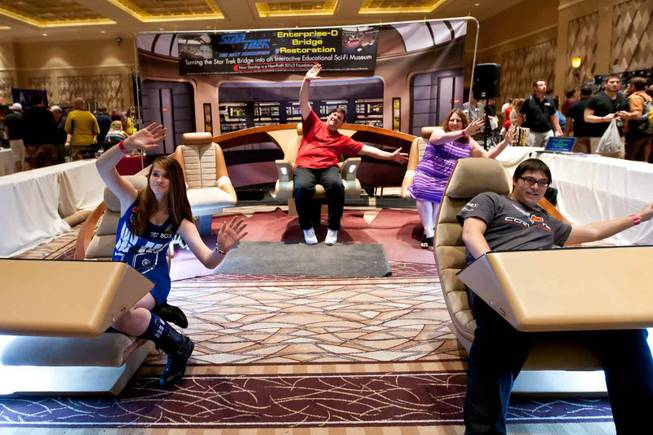 Attendees act while sitting in the Bridge booth at the Official Star Trek Convention at the Rio in Las Vegas on Saturday, Aug. 10, 2013.