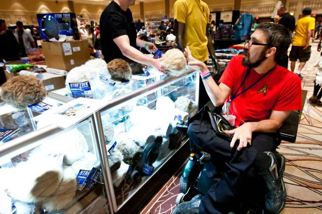 An attendee purchases a Tribble from the Tribble booth while attending the Official Star Trek Convention at the Rio in Las Vegas on Saturday, Aug. 10, 2013.