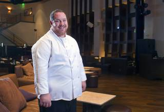 Chef Doug Bell poses in the Heraea restaurant in the Palms Monday, Aug. 12, 2013.