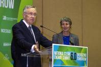 Senate Majority Leader Harry Reid (D-NV) responds to a question about the stalled Yucca Mountain nuclear waste storage facility during a news conference at the National Clean Energy Summit 6.0 at the Mandalay Bay Tuesday, Aug. 13, 2013. Interior Secretary Sally Jewell listens at right.