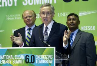 Senate Majority Leader Harry Reid, center, (D-NV) speaks during a news conference at the National Clean Energy Summit 6.0 at the Mandalay Bay Tuesday, Aug. 13, 2013. The Moapa Band of Paiutes announced they will begin construction on a large-scale photovoltaic facility on Moapa River Indian Reservation land northeast of Las Vegas. Behind Reid are Gerrit Nicholas, managing partner of K Road Power, and Eric Lee, acting chairman from the Moapa Band of Paiute Indians.