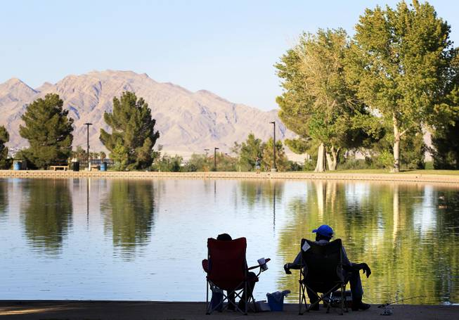 People enjoy the lake view while fishing at Sunset Park in Las Vegas on Tuesday, August 13, 2013.