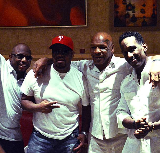 Mike Tyson, second from right, with Mirage headliners Boyz II Men at the Mirage.