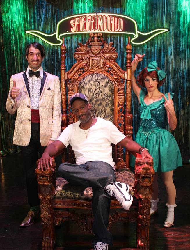 "Shawn Stockman of Boyz II Men is flanked by ""Absinthe"" stars The Gazillionaire and Penny Pibbets at Caesars Palace on Thursday, Aug. 8, 2013."