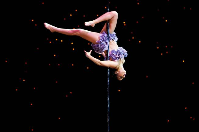 Artist Deb Mekhael performs during the amateur Championship Level 3 Senior competition at the 2013 U.S. National Pole Championships at the Tropicana Hotel in Las Vegas Friday night, August 9, 2013.