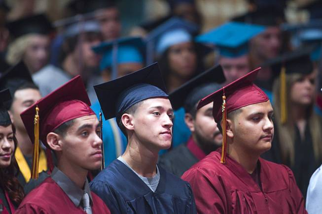Graduates listen to a keynote address by Las Vegas City Councilman Ricki Barlow during the Clark County School District's second annual summer high school graduation ceremony for summer school graduates and at-risk students at the Las Vegas Academy in downtown Las Vegas Wednesday, Aug. 14, 2013.