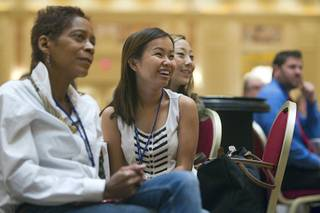 New teacher Jenny Nguyen, center, listens to Las Vegas Mayor Carolyn Goodman during a Clark County School District orientation session for new teachers at the Venetian Thursday, Aug. 15, 2013. Over 1,700 teachers took part in the orientation.
