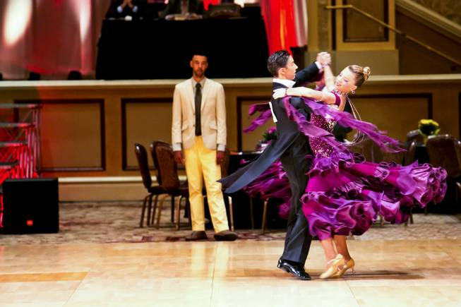 Couples compete during the 2013 NV Star Ball Dancesport Championships at Green Vallet Ranch Resort, Spa & Casino, Thursday Aug. 15, 2013.