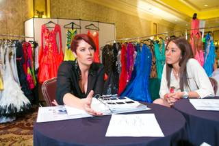 Kristy Rivers and Briana Haft, of Dore Exquisite Gowns, talk about the start-to-finish process behind their companies' extravagant ballroom gowns, Thursday Aug. 16, 2013. Dore's exquisite gowns are on display at the 2013 Nevada Star Ball dance championship at Green Valley Ranch Resort, Spa & Casino.
