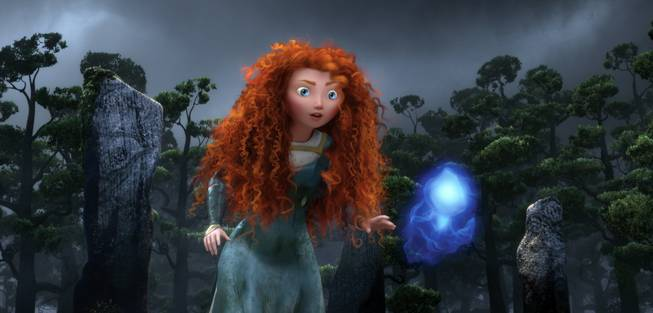 "In this undated publicity film image released by Disney/Pixar, the character Merida, voiced by Kelly Macdonald, follows a Wisp in a scene from ""Brave."""