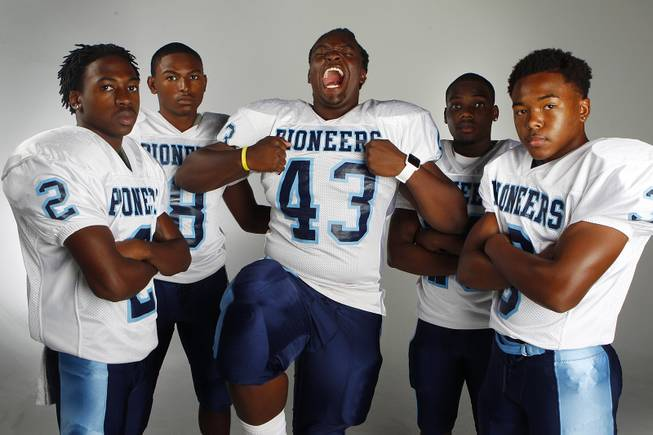 Canyon Springs football players, from left, defensive back Raequan Bascombe, linebacker Isiah Carter, defensive lineman Rayshawn Henderson, running back Zaviontay Stevenson and defensive back A.J. Cooper.