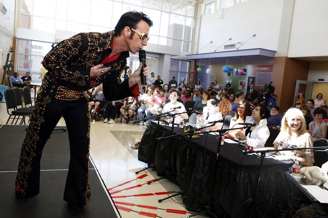 Tony Felicetta performs in an Elvis impersonator contest on the anniversary of Elvis' death at Opportunity Village Engelstad Campus in Las Vegas on Friday, August 16, 2013.