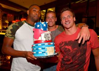 Ryan Lochte, right, with Cullen Jones and Ed Moses, celebrates his 29th birthday at SHe in Crystals at CityCenter on Friday, Aug. 16, 2013.