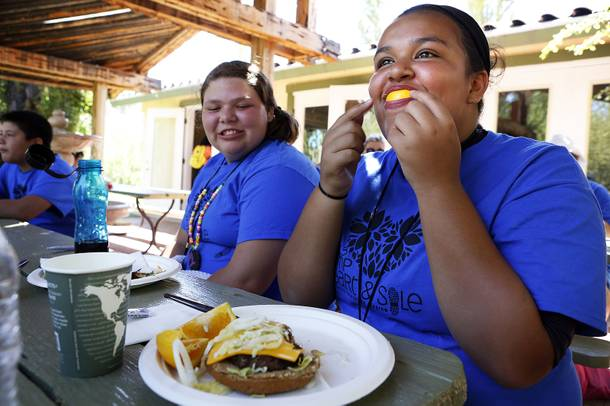 Camper Emily Lai, 14, has fun with an orange slice during lunch at Camp Heart and Sole at Torino Ranch in Lovell Canyon on Saturday, August 17, 2013.