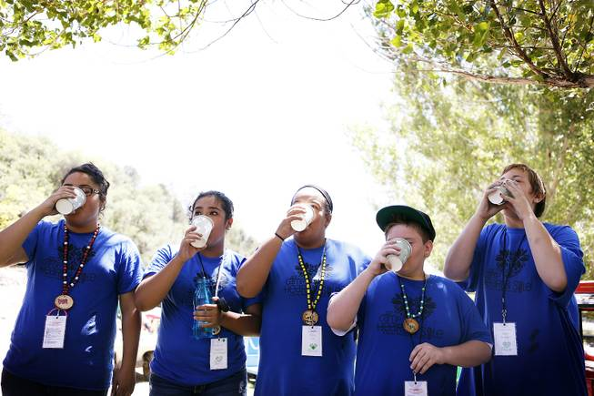Campers participate in a water drinking contest at Camp Heart and Sole at Torino Ranch in Lovell Canyon on Saturday, August 17, 2013.