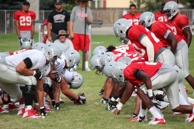 The Rebels' defensive front awaits the offensive snap during a scrimmage on Saturday, August 17, 2013, in Ely.