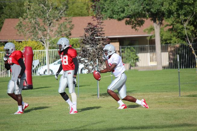UNLV freshman Kendal Keys runs back to his teammates to after catching a touchdown during scrimmage on Saturday, August 17, 2013, in Ely.