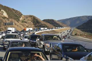 A fire on the Cajon Pass on Sunday afternoon blocked traffic on Interstate 15 for more than an hour. It was part of a busy afternoon. A wreck caused miles of congestion in Baker earlier in the day.