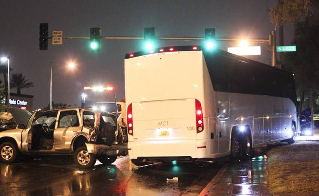 A five car accident, including a tour bus, is seen on Oneida Way and Desert Inn during a rainy evening, Sunday, Aug. 19, 2013.