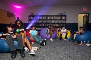 Friends hang out on bean bags in the new teen center during the grand-opening party funded by Sands Expo at the Boys and Girls Club at 2850 S. Lindell Road in Las Vegas Monday, August 19, 2013.