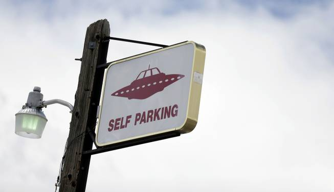 A sign indicates UFO parking at the Little A'Le'Inn, located nine miles up the road from the military testing base known as Area 51, in Rachel, Nev., Aug. 20, 2013. Last week, the CIA released a classified report officially confirming the existence of the military testing base famously rumored to have researched UFOs and alien life, though residents of the area have long known about it.