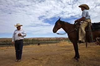 Rancher Cliven Bundy, left, and his son, Arden, stand on land the family has worked since the 1880s on August 20, 2013, in Bunkerville, Nevada. Bundy is battling the Bureau of Land Management over grazing rights.