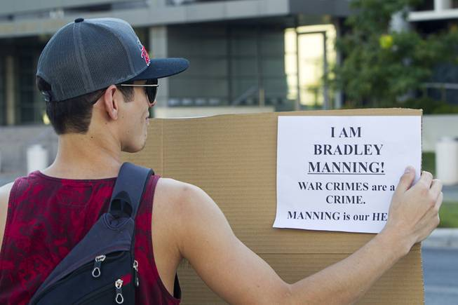 Nicandro Gomez pickets in support of Army Pfc. Bradley Manning in front of the Lloyd George Federal Building in downtown Las Vegas Wednesday, Aug. 21, 2013. A military judge sentenced Manning to 35 years in prison for leaking hundreds of thousands of classified documents to WikiLeaks.