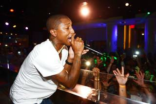 Pharrell Williams performs at Pure in Caesars Palace on Wednesday, Aug. 21, 2013.