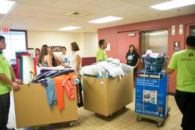 Students move into the dorms at UNLV during campus move-in day, Thursday Aug. 22, 2013.