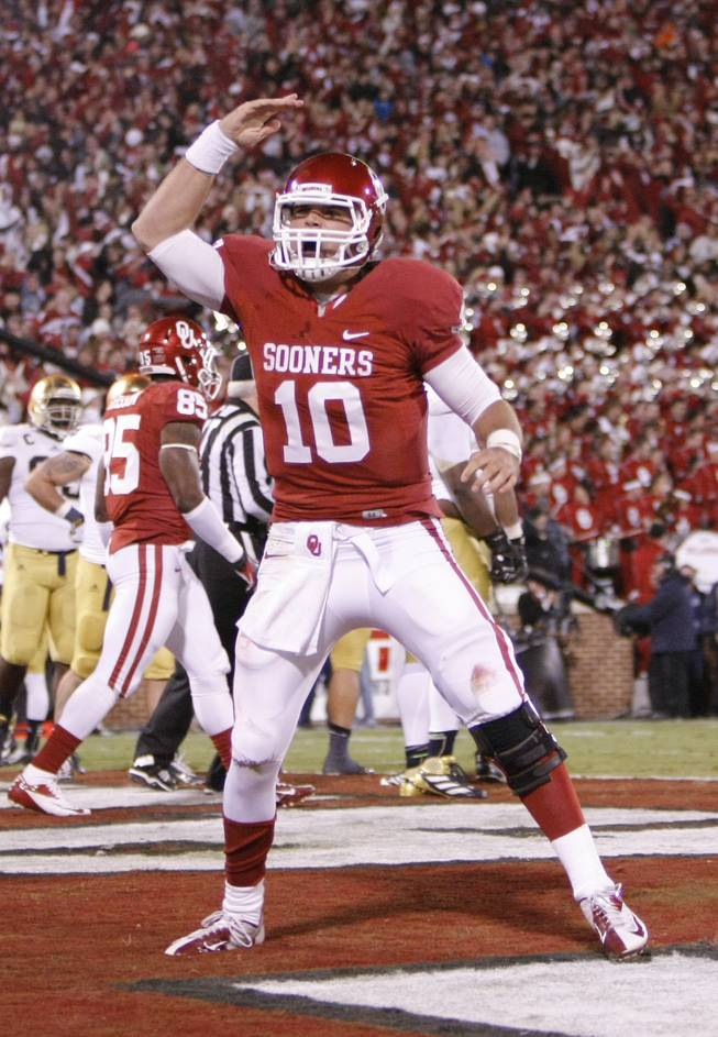 Oklahoma quarterback Blake Bell (10) celebrates during the second half of an NCAA college football game in Norman, Okla., Saturday, Oct. 27, 2012.